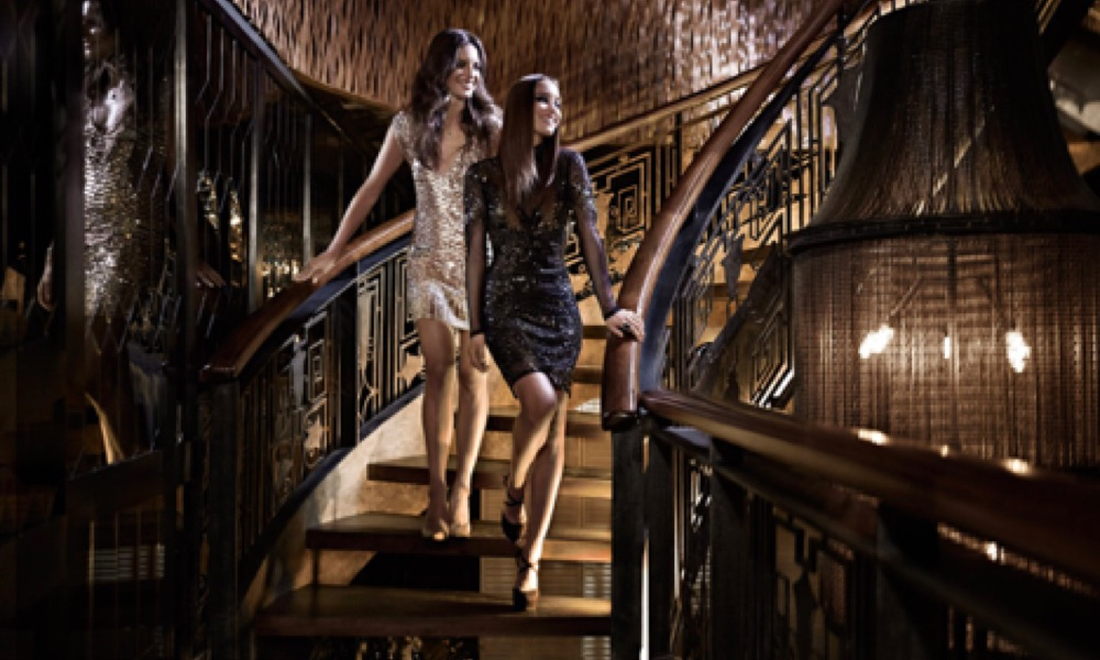 Girls walking downstairs-lighting- hospitality design services