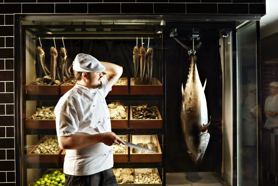 Chef with fish at Robert-marchetti-QT-Hotel-Sydney
